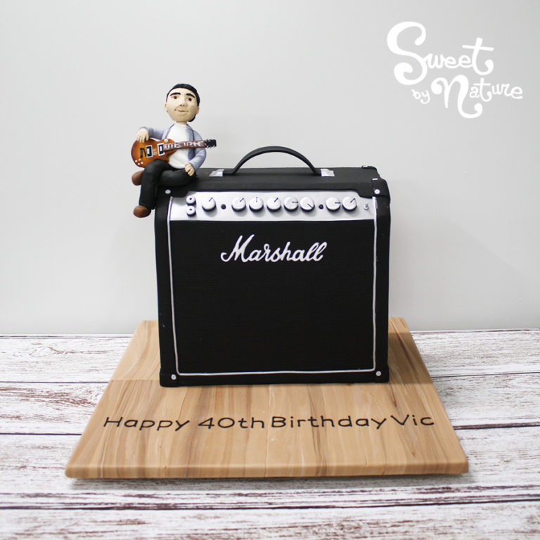 Novelty Marshall AMP with figurine and guitar and wood grain board