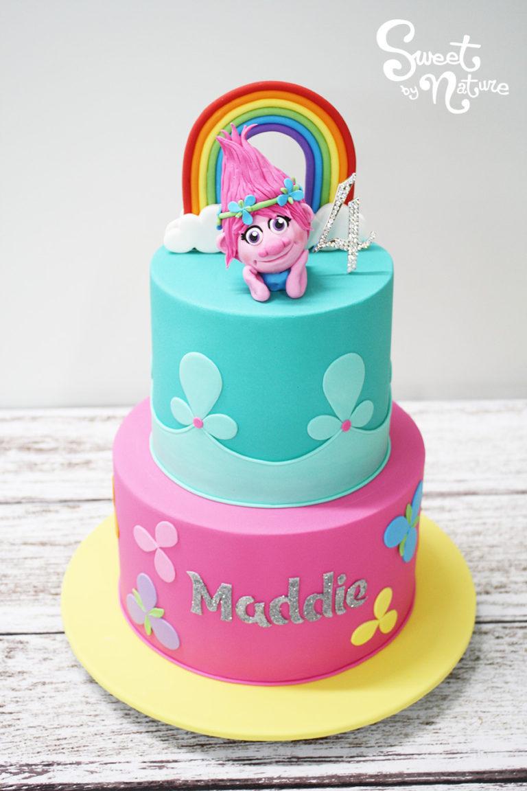Two Tier Rainbow Trolls Figurine Cake